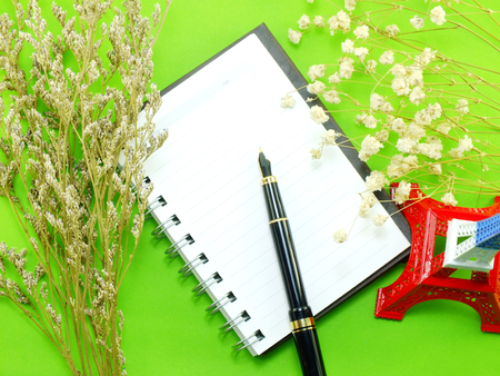 dried flower arrangement: dried flowers and empty notebook page