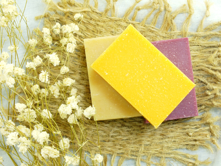 bath sponge: natural handmade herbal soap spa with bath sponge on whit background