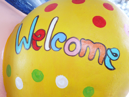 welcome mat: colorful welcome text wording made with hand writing