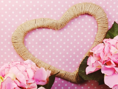 heart symbol decoration with artificial roses Stock Photo