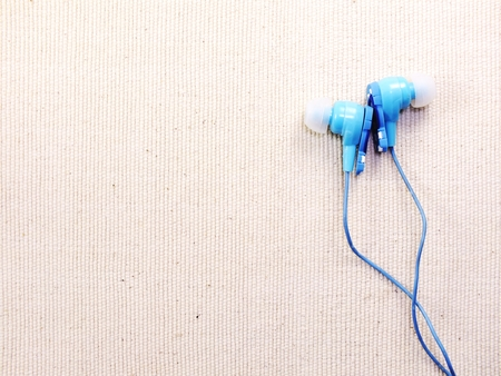 earbud: earbud or earphone on background