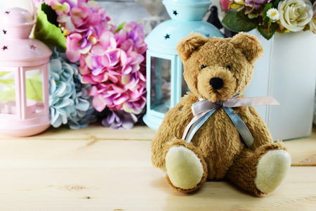 beautiful interior decoration teddy bear with different home related objects Stock Photo