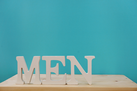 men word letters with space copy on wooden background Stock Photo
