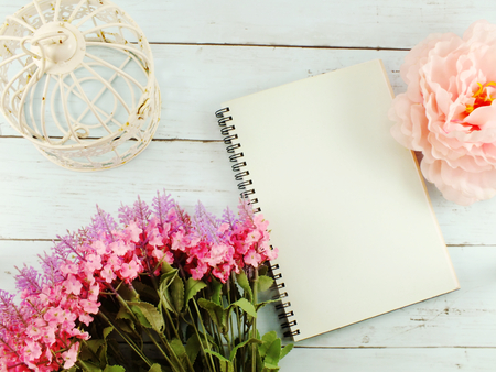 flowers bouquet and blank notebook with copy space background