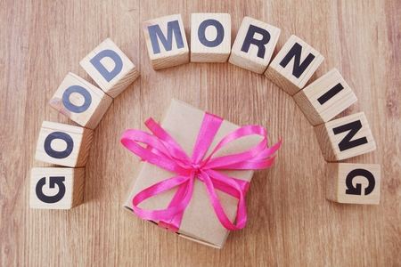 good morning wooden letter alphabet on wooden background