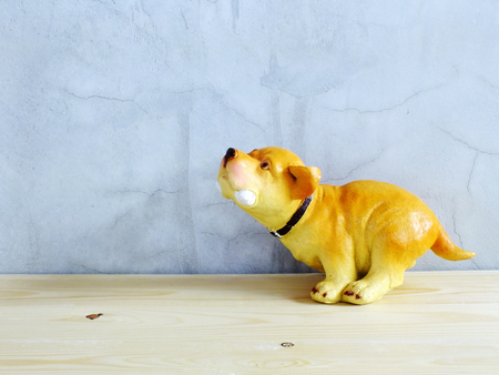 dog statue ceramic with space copy on wooden background