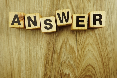 answer word in wooden cube alphabet letters top view on wooden background