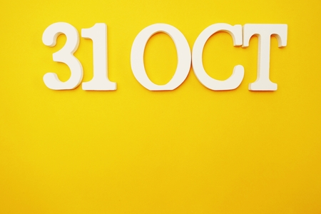 31 october on yellow background top view on yellow background with copy space