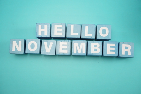 Hello November alphabet letters with space copy on blue background
