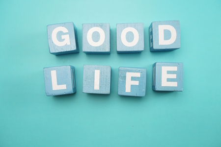 Good Life created with cubes alphabet letters on blue background 版權商用圖片