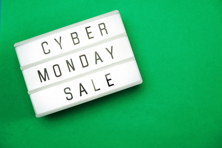 cyber monday sale flat lay top view on green background