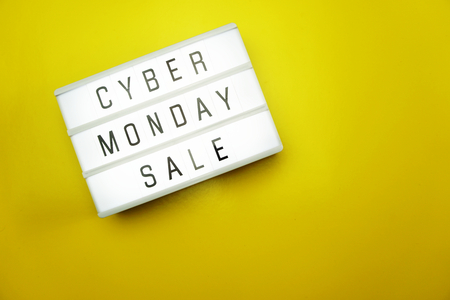 cyber monday sale flat lay top view on yellow background Stock Photo
