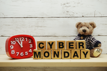 Cyber Monday sale shopping concept alphabet letter and alarm clock on wooden background