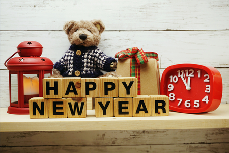 hapy new year alphabet letters on wooden background