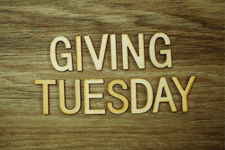 Giving Tuesday text message on wooden background Stock Photo