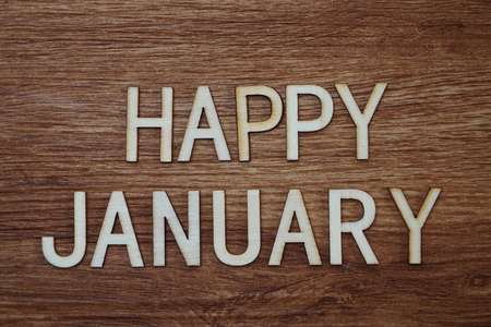 Happy January text message on wooden background