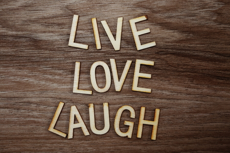Live Love Laugh text messege on wooden background 版權商用圖片