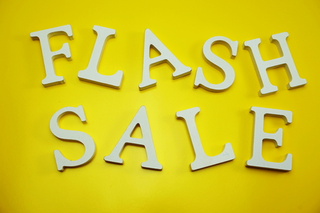 Flash Sale alphabet letters on yellow background business concept