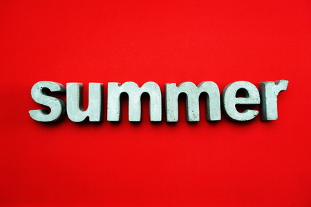 Summer alphabet letters on red background 写真素材