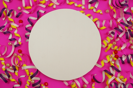 Flat Lay colorful celebration background with confetti on Pink background