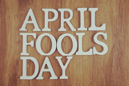 April Fool's Day alphabet letter with space copy on wooden background