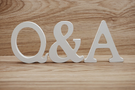 Q & A word alphabet letters on wooden background