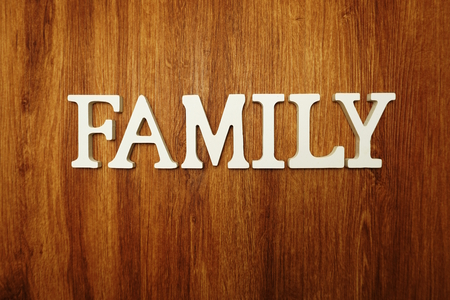 Family word alphabet letters on wooden background