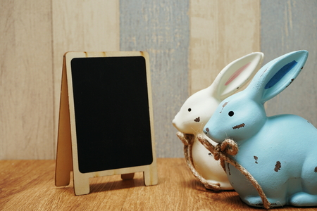 happy easter with bunny rabbit and space copy wooden easel background