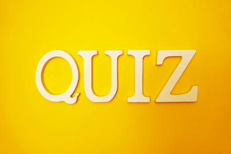 Top view Quiz letters alphabet letters on Yellow background