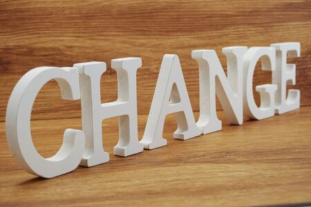 Change word alphabet letters on wooden background