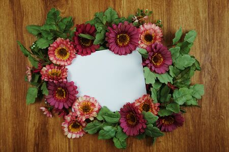 Flat lay of flowers and space copy on wooden background