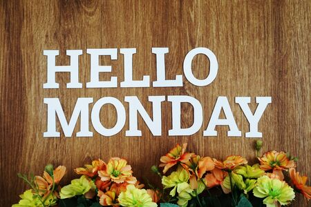 Hello Monday wooden letter alphabet with flower on wooden background 免版税图像