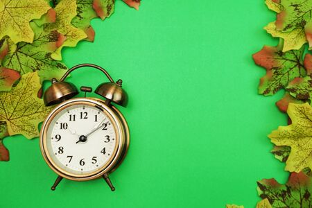 Alarm clock with Maple leaf border on green background