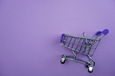Mini trolley cart with space copy on purple background
