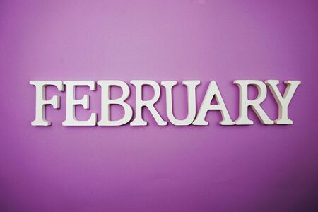 February alphabet letter with space copy on Purple background Banco de Imagens