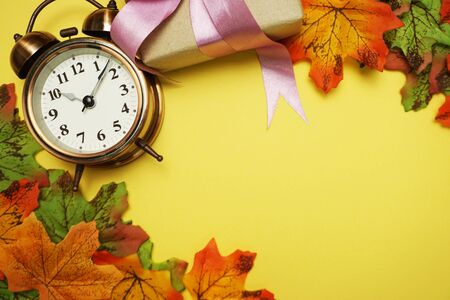 Alarm clock with Maple leaf boder on Yellow background