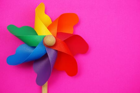 colorful pinwheel with space copy isolated on pink background