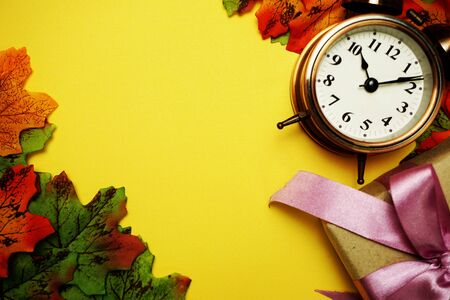 Alarm clock with Maple leaf border on Yellow background