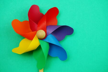 colorful pinwheel with space copy isolated on green background 写真素材