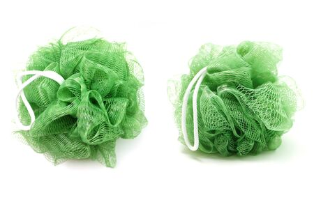 Green bath soft with rope isolated on white background Foto de archivo - 127828927