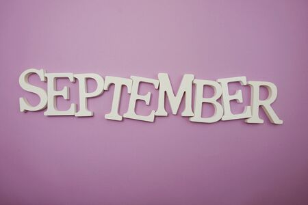 September alphabet letters on purple background