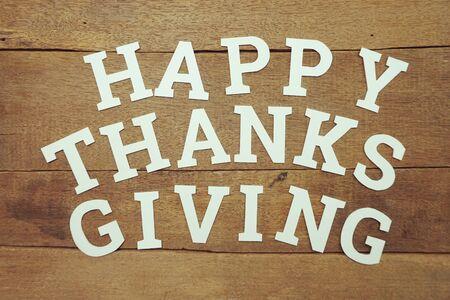 Happy Thanksgiving alphabet letters on wooden background Banco de Imagens