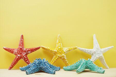 summer background starfish figure decoration on yellow background Banco de Imagens