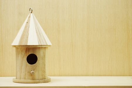 wooden bird house with space copy on wooden background Banco de Imagens