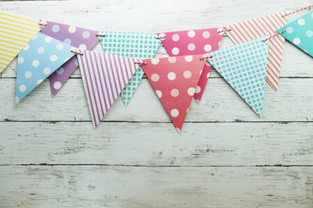 Colorful Bunting hanging with space copy on wooden background