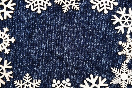 Christmas frame of snowflakes on Knitted background texture Banco de Imagens