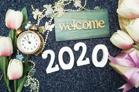 Happy New Year 2020 with welcome sign, gift box and alarm clock decoration background Banco de Imagens