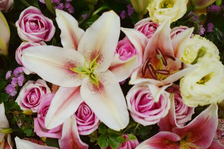 Lily and Pink roses flower bouquet background