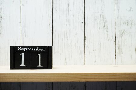 11th September Wooden Calendar with space copy background Foto de archivo
