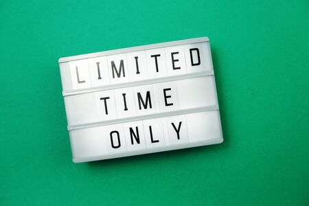 Top view Limited Time Only word on light box Flat lay with space copy on green background Stock Photo